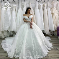 Luxury Wedding Dress 2019 Princess Swanskirt Appliques Beaded Lace up Ball Gown Chapel Train Bridal Gown Vestido de Noiva XZ03