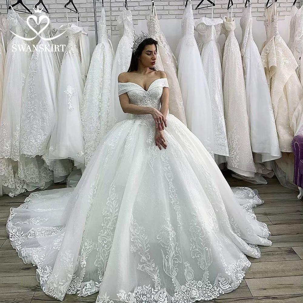 Luxury Wedding Dress 2019 Princess Swanskirt Appliques Beaded Lace up Ball Gown Chapel Train Bridal Gown Vestido de Noiva XZ03