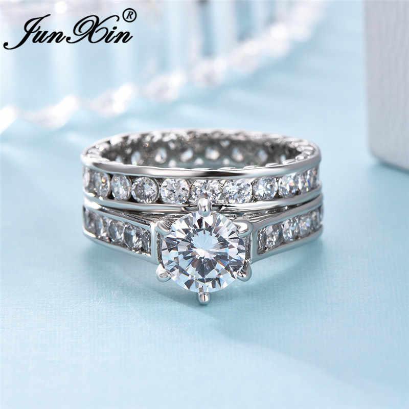JUNXIN หญิงคริสตัลรอบคู่แหวนเงินสีขาวทองหมั้นงานแต่งงานแหวนแหวน Zircon ชุดเจ้าสาว