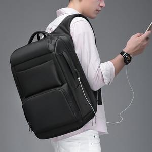 Image 2 - EURCOOL حقيبة السفر الرجال متعددة الوظائف سعة كبيرة الذكور موتشيلا حقائب USB شحن ميناء 17.3 بوصة محمول حقائب الظهر المدرسية