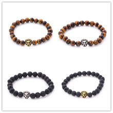 8041ea66c7 Fashionable natural tiger s Eye Bracelet lava volcanic rock lion head  Buddha bead bracelet ornaments Charming gift