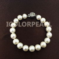 Best Price For 9.5 10.5mm Potaotoround White Freshwater Pearl Bracelet On Elastic Or With A Flower Clasp