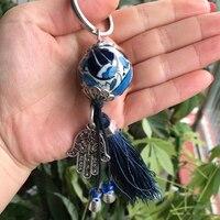 Turkish Evil Blue Eye Schlüsselanhänger Schlüsselring Handgefertigte Keramik Ball Hamsa Hand Charme Absorbiert Negative Energie Arabische Islamische Auto Amulett