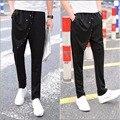 M-5XL NUEVOS hombres no convencionales de moda pantalones harén pantalones flacos delgados marea personalidad faux dos pantalones pieza cantante disfraces