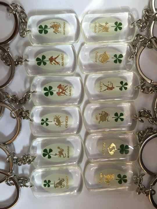 Livraison gratuite ensemble porte-clés bijoux véritable shamrock douze constellations charmant porte-clés