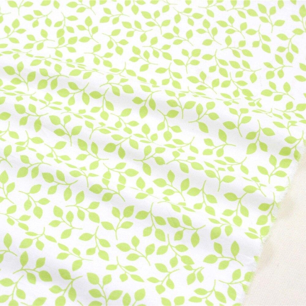 1509301, envío gratis 50 cm * 150 cm historieta de las hojas de tela de algodón