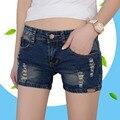 2017 Mujeres Azul Oscuro Shorts Ripped Flaco Verano Pantalones Cortos de Mezclilla de Moda Casual de Alta Elasticidad de Algodón de Las Mujeres Agujerean Los Pantalones Vaqueros Cortos