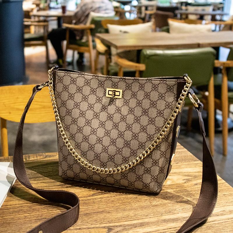 Fashion women 39 s bag 2019 summer new crossbody bag printing bucket bags wide shoulder strap single shoulder bag women handbag in Top Handle Bags from Luggage amp Bags