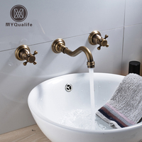 Antique Brass Basin Faucet Dual Handles Retro Style Wall Mounted For Cold And Hot Water Tap