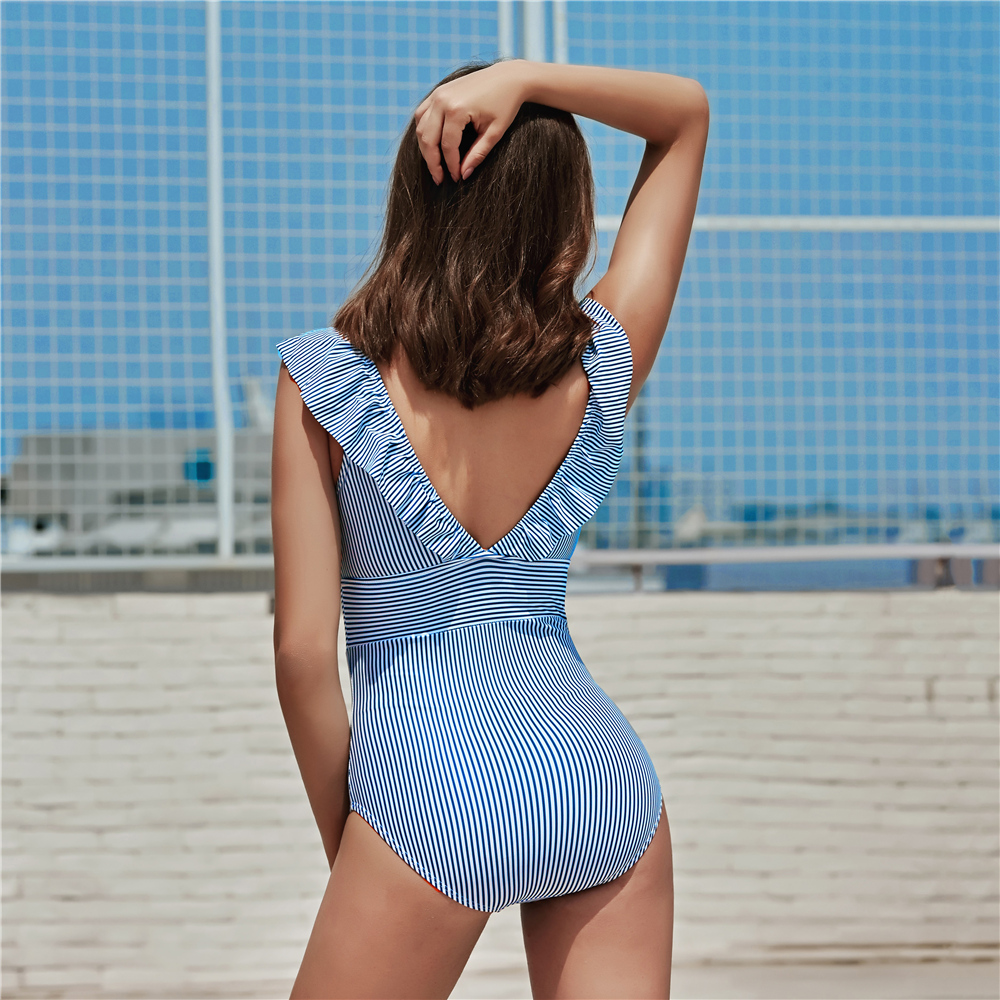 Foto on the body from the back women's one-piece v-neck swimsuit. Female one-piece swimwear for swimming pool