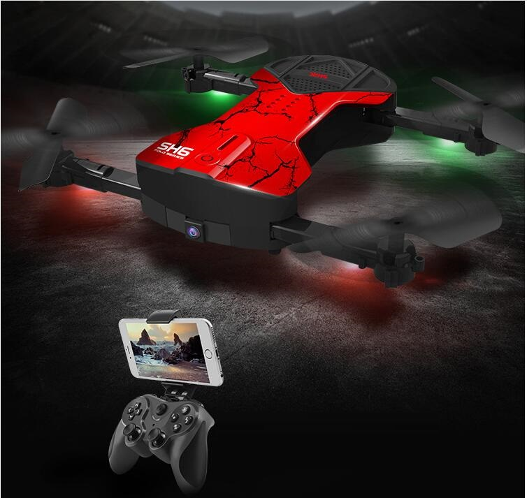 Фотография Hot sale Foldable storage remote control drone SH-6 wifi fpv real time transmission set attitud hold portable RC helicopter toy