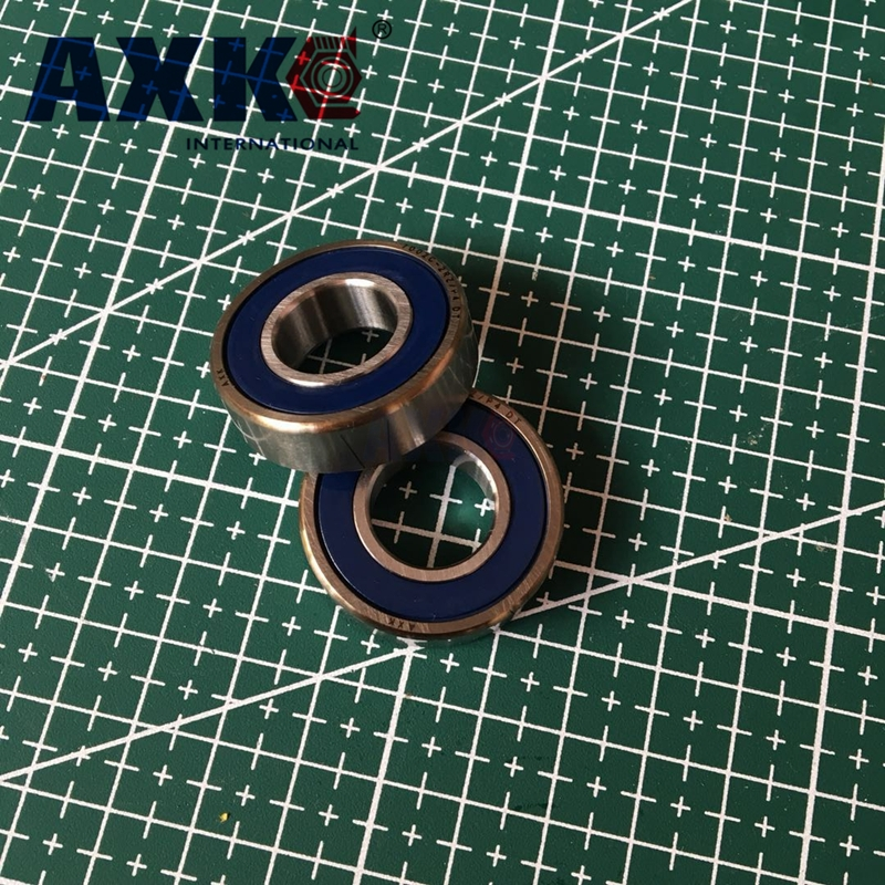 купить AXK 1 pair 7002 7002C 2RZ P4 DT A 15x32x9 15x32x18 Sealed Angular Contact Bearings Speed Spindle Bearings CNC ABEC-7 по цене 1816.89 рублей