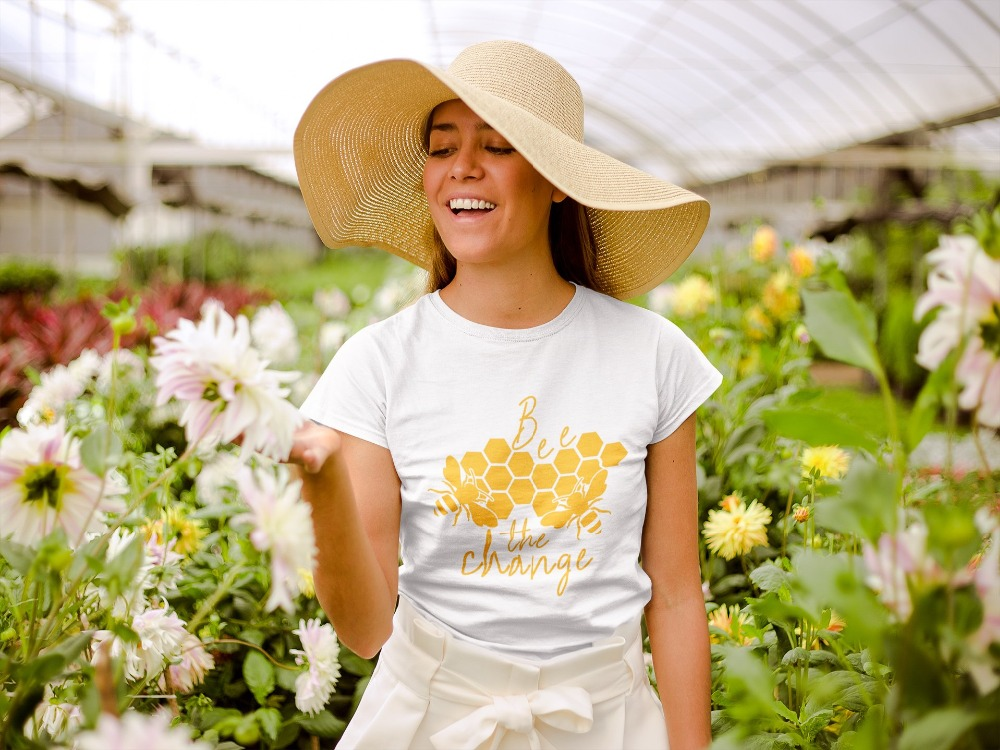 mockup-of-a-happy-girl-wearing-a-tshirt-and-a-sun-hat-in-a-greenhouse-22500_2_1024x1024@2x