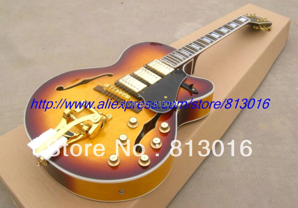 все цены на Wholesale Musical instrument customised electric guitar jazz  gold hardware honey burst finished with bigby+ Free shipping онлайн