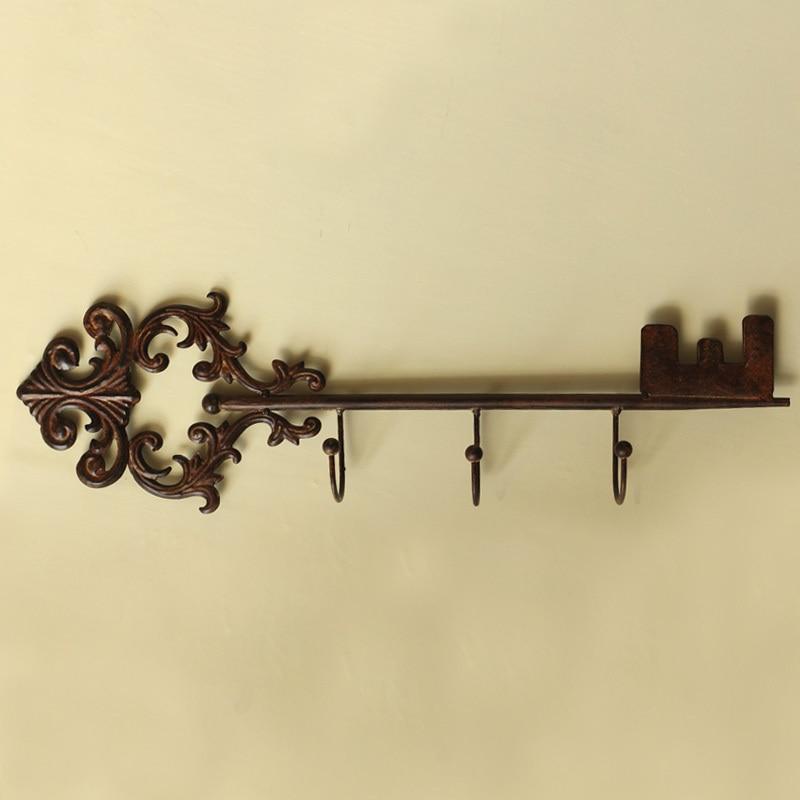 81481a8c507 Retro criativo europeu Tieyi de metal peg gancho pendurado gancho chave  Início Mobiliário decorações murais