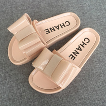 2018 new jelly slippers female non-slip crystal big bow word flip-flops flat beach sandals and slippers.