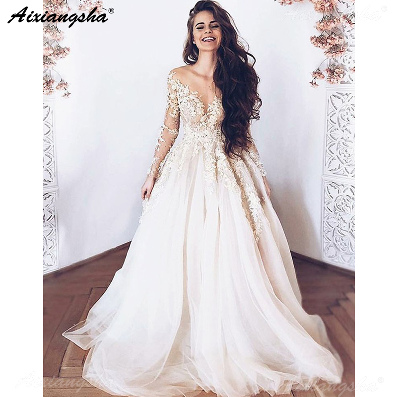 Image 1 - Vestido De Noiva 2019 Romantic Wedding Dresses A Line Long Sleeve Lace Dubai Arabic Wedding Gown Ivory Bride Dress-in Wedding Dresses from Weddings & Events