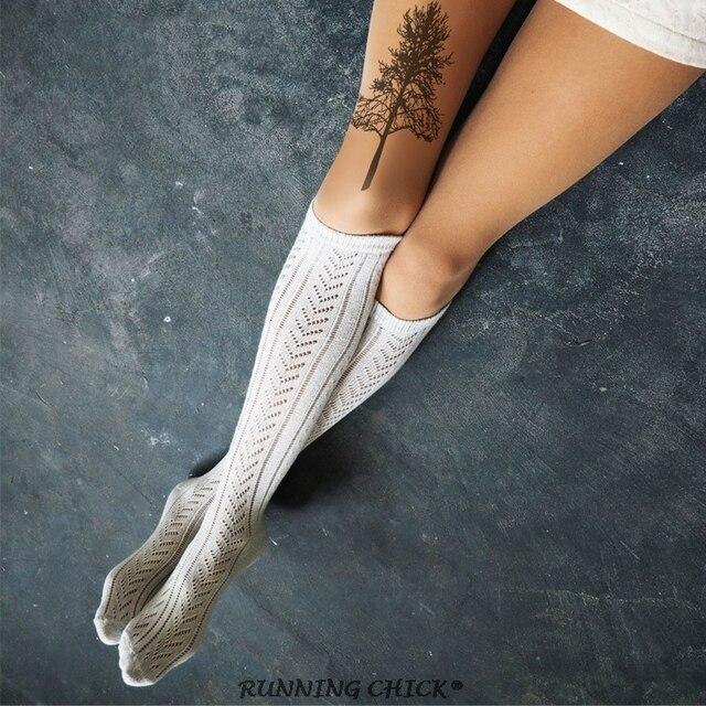 noir petit arbre silhouette mince collants cuisse jambe de tatouage