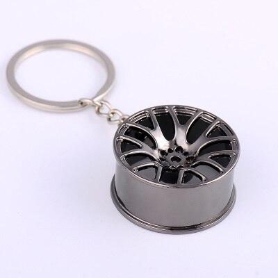 Творческий автомобиль концентратора Форма металлический брелок металлической цепочкой цинковый сплав турбины переоборудованы колесо висит аксессуар брелок подарок 2 шт - Цвет: Черный