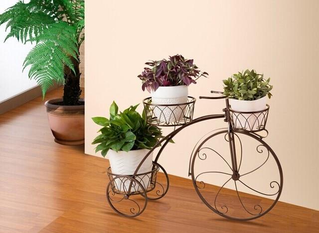 La bicicleta puesto de flores / estante, la tierra / balcón ...