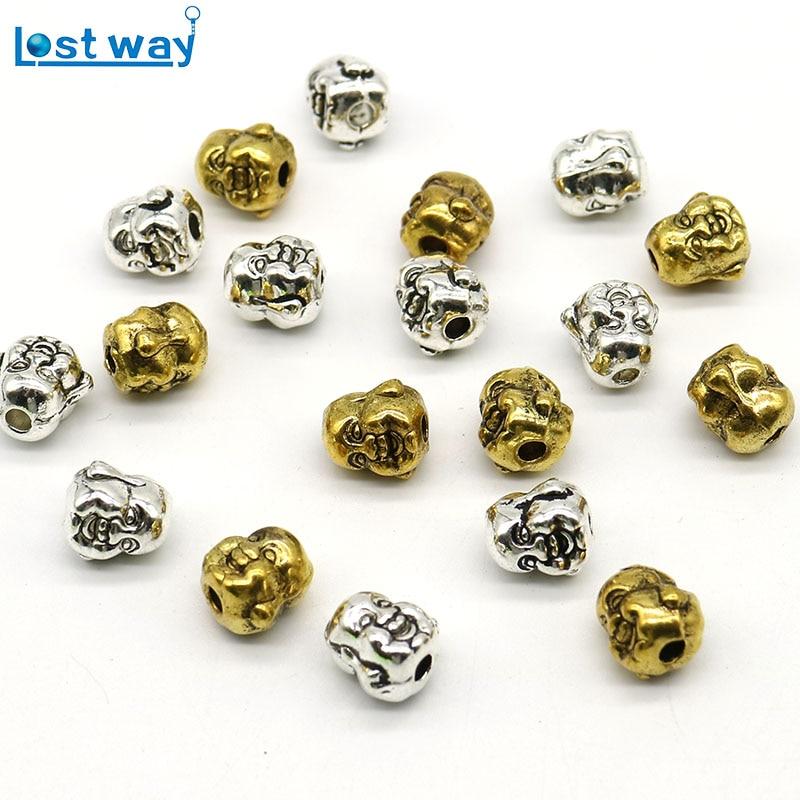 10x8 մմ մեծածախ 20 հատ / լիտր Մետաղական հմայքներ Սայթաքեց Ոսկե ցինկ խառնուրդով ժպիտով Բուդդա Գլուխ Spacer Beads for ոսկերչական իրերի պատրաստման փոս 2 մմ