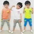 Бесплатная доставка Летом детская одежда хлопка С Коротким рукавом футболка + шорты 2-6 Т Мальчики и девушки спортивная одежда Мальчиков и девочек Костюм