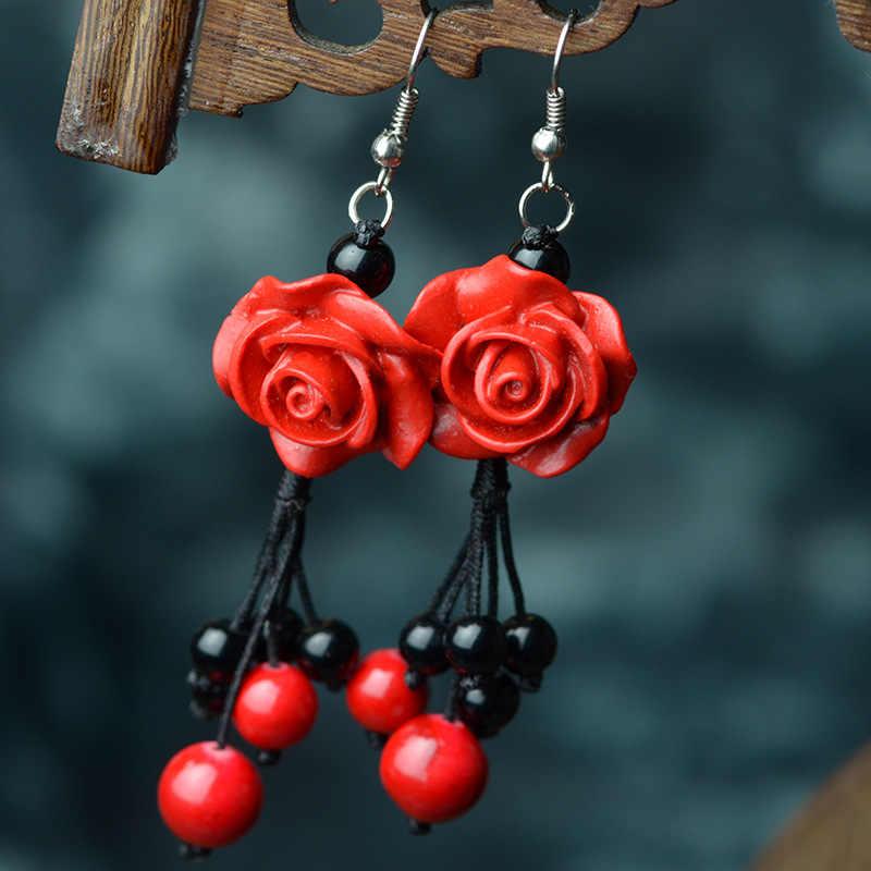 懸滴のイヤリング赤い刻まれた漆器花黒天然石ビーズ亜鉛合金フックエスニックヴィンテージジュエリー