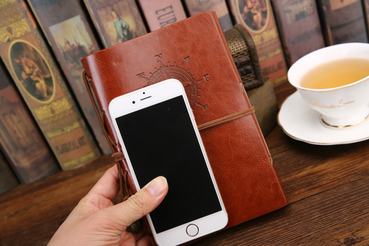 Size of a mobile phone and our leather journals