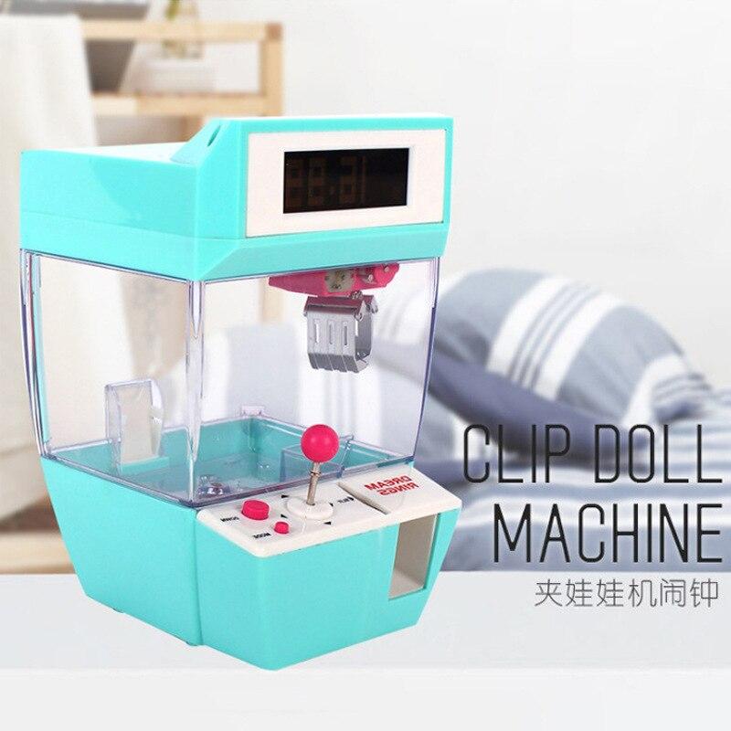 Créatif intéressant multi-fonctionnel mini-grabber réveil pièce clip poupée amusant jeu machine roman et jouets exotiques