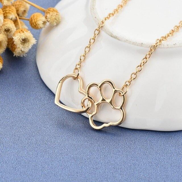 Фото женское ожерелье с подвеской в виде собачьей лапы золотистого цена