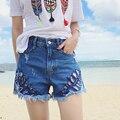Plus size denim jeans shorts mulheres estilo verão 2016 feminina borla venda quente Buraco shorts jeans femininos A2357