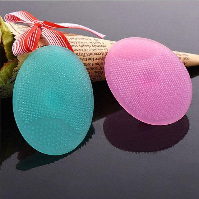 Venta caliente 1 PC Gel de silicona en forma de huevo para lavar la cara almohadilla de limpieza Facial cepillo exfoliante SPA piel exfoliante herramienta de baño color al azar