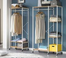 Wardrobe rack. Floor-to-ceiling, minimalist clothes rack. A steel frame closet..