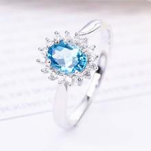 Женское кольцо из серебра 925 пробы с натуральным голубым топазом