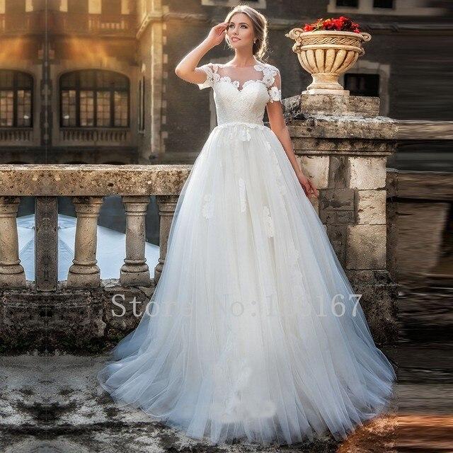 2017 recién llegado de una línea de vestidos de novia de manga corta