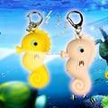 Lovely hippopotamus voiced LED flashlight key chain car lovers gift phone bag pendant ornaments Creative toys Novelty Lighting