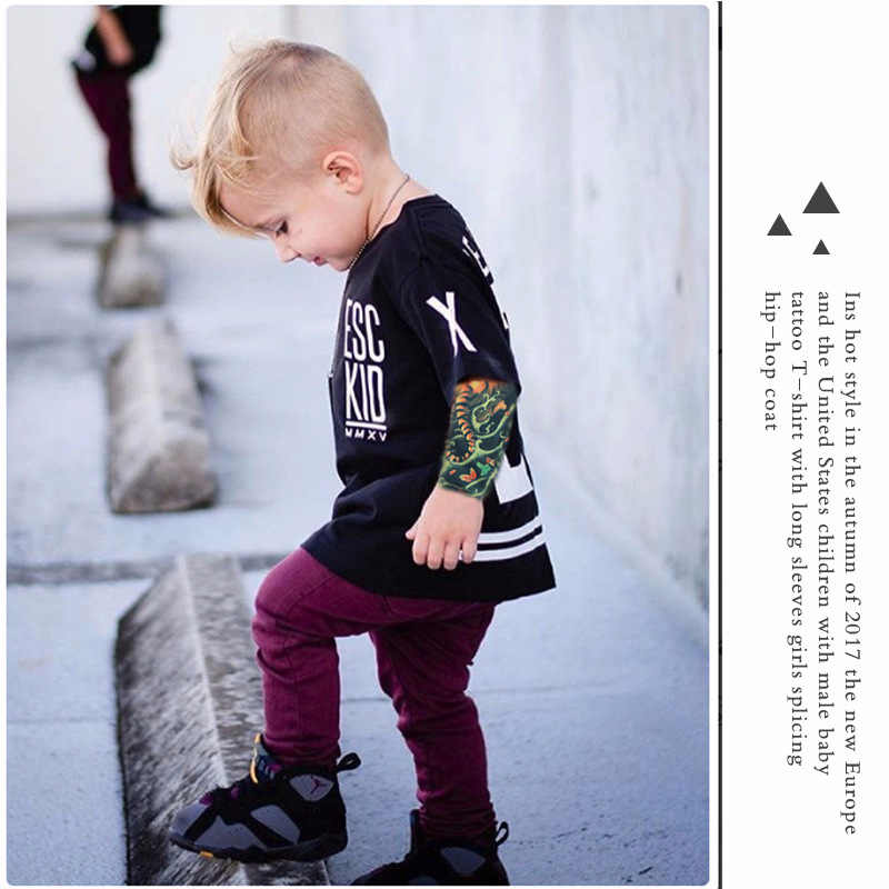 92dab52ca2d26 New Children clothing black punk rock T-shirt male baby tattoo long-sleeved  printed girl stitching shirt Kids handsome clothes