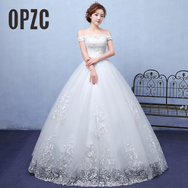 e1dda4bef Venta caliente 2018 nueva moda Real foto blanco encaje bordado vestidos de  novia barco cuello corto