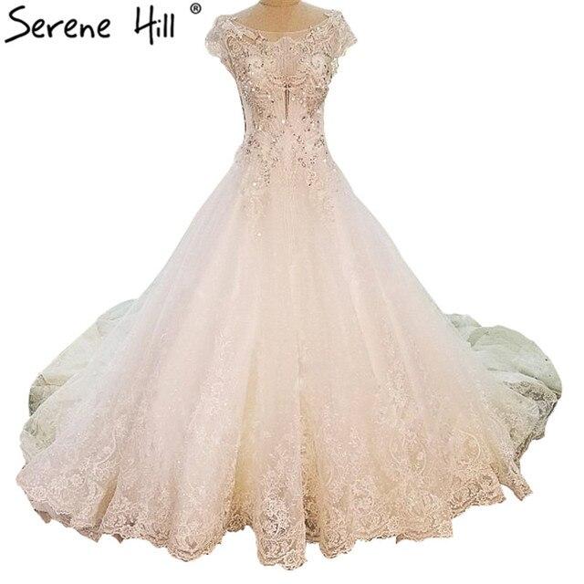 Extreme Luxury Retro Tulle Bridal Wedding Dresses White Sexy Sleeveless  Wedding Gowns Vestido De Noiva 2018 New 152c5b6b976a
