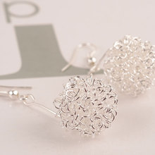 Korean version hot sale with simple wire ball hollow lady earrings