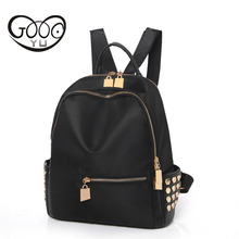 Gold hardware accessories rivets decorated backpack women luxury brand duffle bag nylon solid color travel shoulder bags