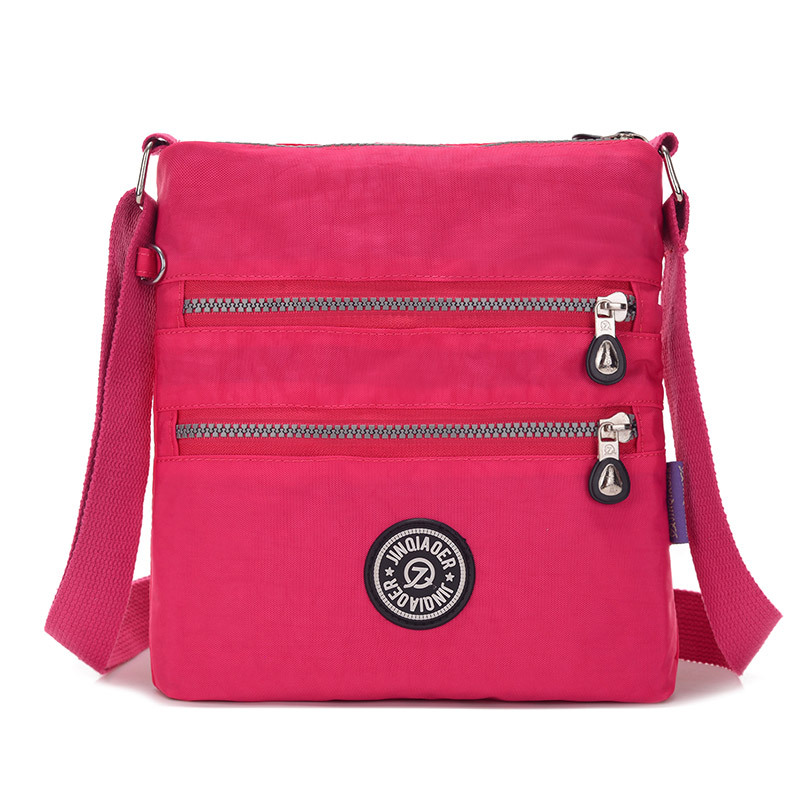 купить JINQIAOER brand Small Nylon Messenger Bag Women Waterproof Crossbody Bags Double Layer Satchels Shoulder Bag For Iphone Bolsa по цене 645.98 рублей