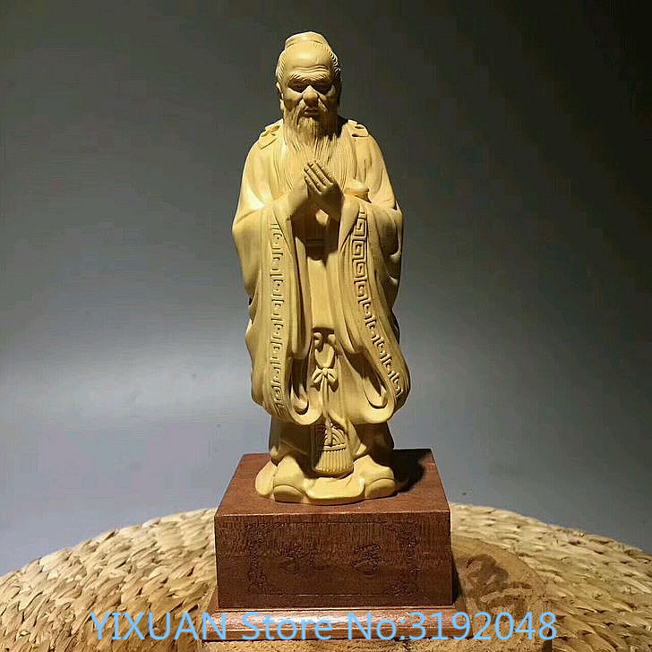 TNUKK  The statue of Confucius, the great educator of China, the sculptures of the office of the home office of the boxwood.TNUKK  The statue of Confucius, the great educator of China, the sculptures of the office of the home office of the boxwood.