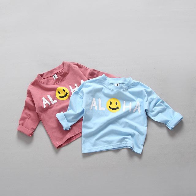 2016 Nueva Moda de primavera desgaste Del Bebé Niños Ropa de La Muchacha Sonrisa Letra de la Historieta de Manga larga Camisetas Lindas Camisetas de Punto de Algodón Básica Tees