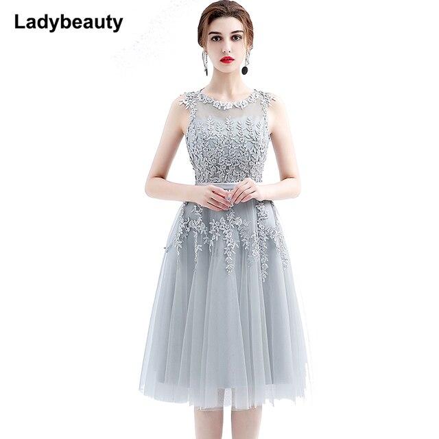 2018 Short Wedding Dresses Elegant Sleeveless Lace Sheer Back Tea