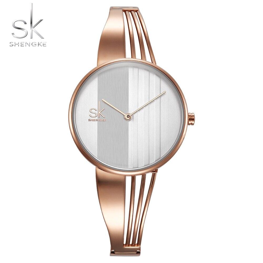 Shengke de moda chapado en oro de las mujeres relojes encanto señoras reloj de pulsera reloj de cuarzo Montre Femme Relogio femenino