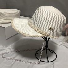 Yeni moda rafya saçaklı kağıt hasır şapka beyaz siyah kadın uzun inciler dize vizör güneş şapkası yaz plaj kap Derby harbiyeli kap