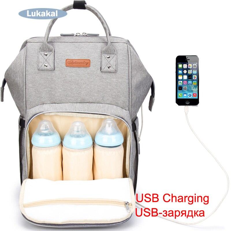 2018 nuevo interfaz USB del pañal del bebé grande bolsa mamá bebé mochila cuidado impermeable Luiertas momia maternidad bebé pañal bolsa