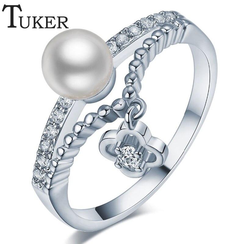 0694a2b3aa62 Tuker simulado anillo de perlas de imitación para las mujeres Venta  caliente diseño único apertura Anillos cóctel joyería en rodio plateado