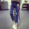 Frete grátis mulheres primavera outono denim calças buracos calças de brim das senhoras calças jeans de corpo inteiro azul dos desenhos animados impressão calças calca feminina 5XL